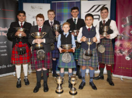 The trophy winners at the National Piping Centre's 2019 annual junior piping competition.