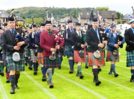 Oban 2017. The annual march through the town to Mossfield Park for the light music competitions at the Argyllshire Gathering is led by the previous day's winner of the Gold Medal and Silver Medal.