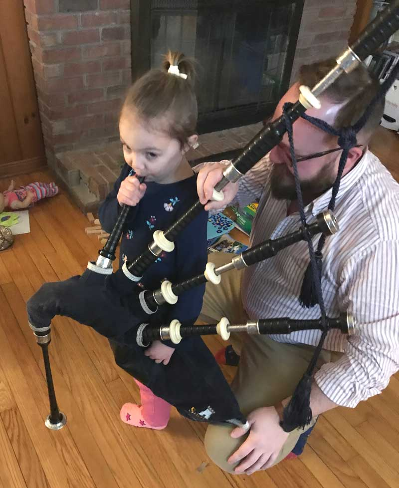 Wee JoJo gets her first shot at a set of pipes. Future Shotts player for sure! (Photo permission granted from JoJo's parents).