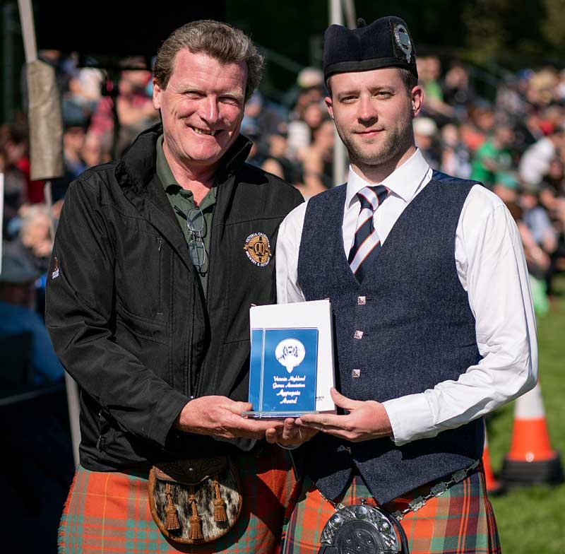 Alastair Lee receiving the Open Piobaireachd award from Graeme Macaloney at the 2019 Victoria Highland Games and Celtic Festival.