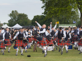 Field Marshal Montgomery Pipe Band celebrate the announcement of their grade one British Championship win.
