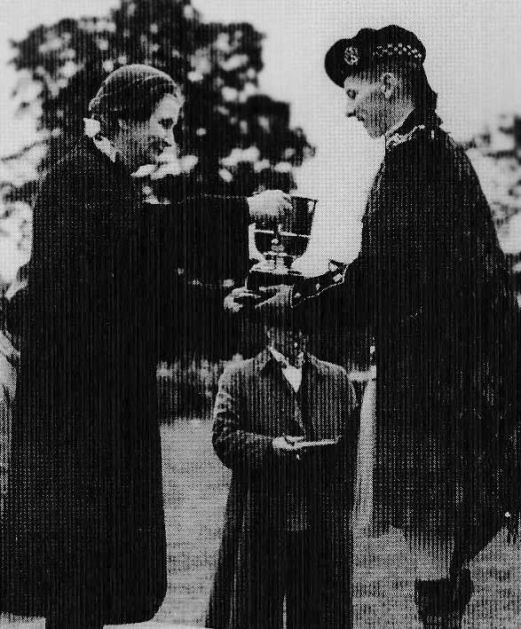 Jimmy receives the Grade 2 trophy at Dunblane Highland Games on behalf of the NCR Pipe Band. Date unknown.