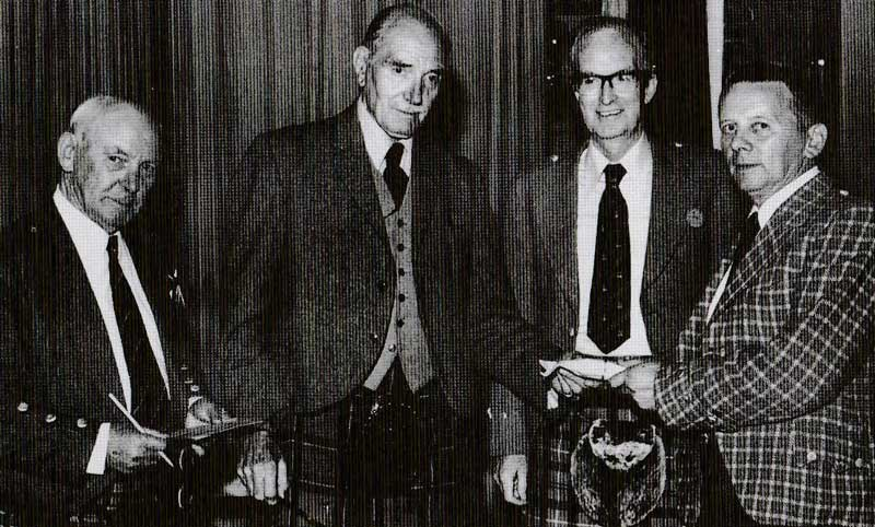 Receiving the Oban Gold Medal in 1976 from judges Ronnie MacCallum, Dr. Colin Caird and Seumas MacNeill.