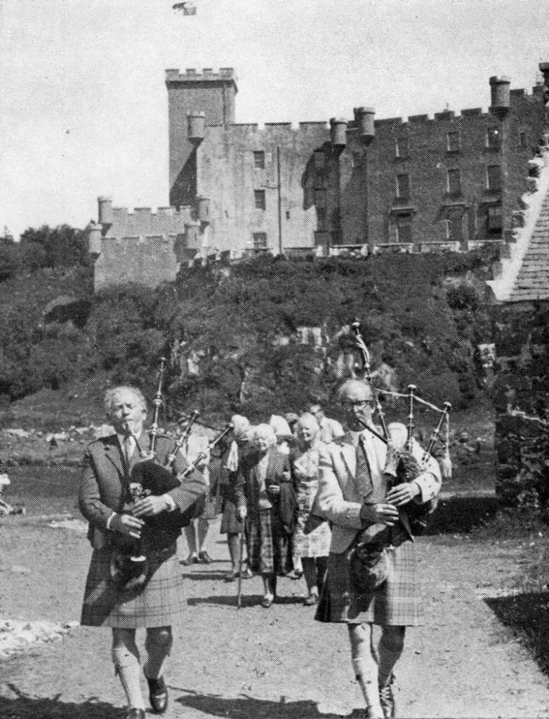 Seumas MacNeill and John MacFadyen at Dunvegan Castle. The woman behind them in the centre is Dame Flora MacLeod of MacLeod. Late 1960s.