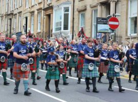 The Piping Live! Big Band parading down West George Street in 2017.