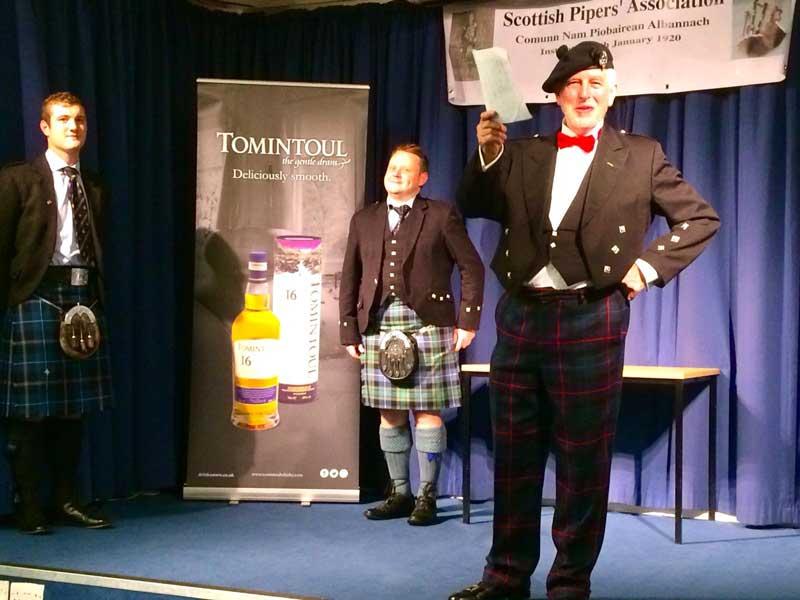 SPA President, Tom Johnstone announces the winner.