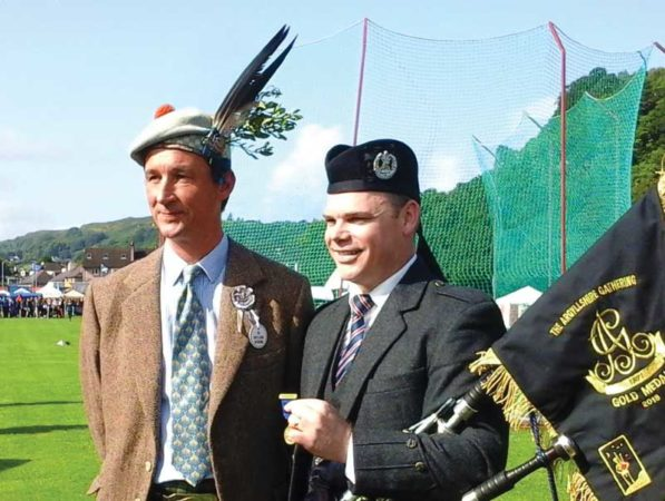 The Duke of Argyll presents Stuart Easton with the Gold Medal and pipe banner at Oban Games 2018.