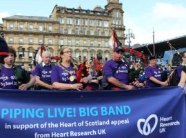 Lord Provost Eva Bolander joins the Piping Live! Big Band for a tune on George Square today.
