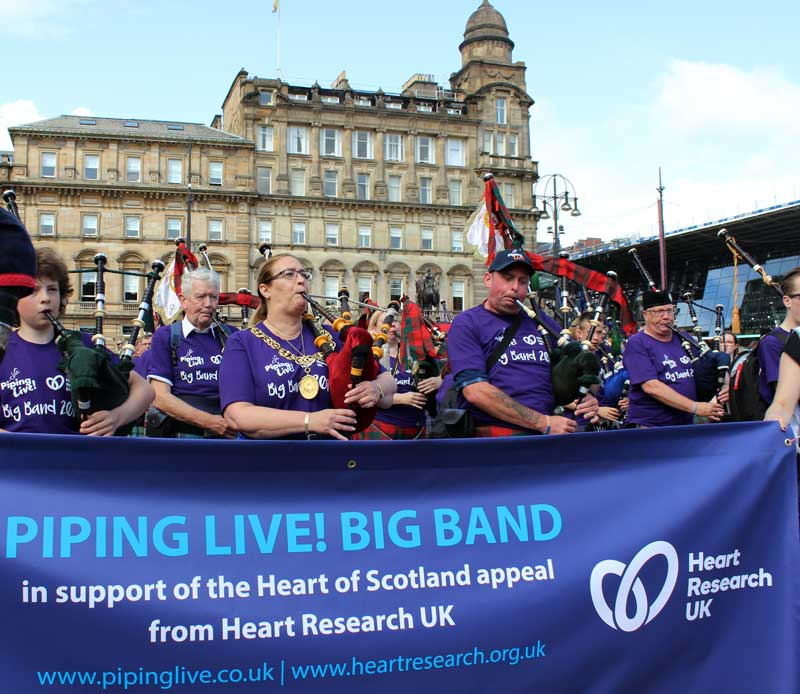 Lord Provost Eva Bolander joins the Piping Live! Big Band for a tune on George Square.