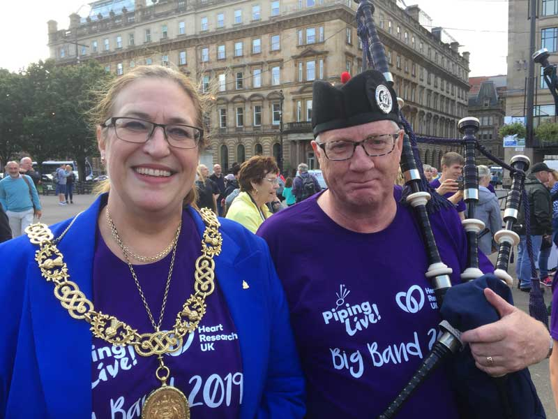 Glasgow's Lord Provost Eva Bolander with Bill Bennett on George Square after the Big Band Parade.