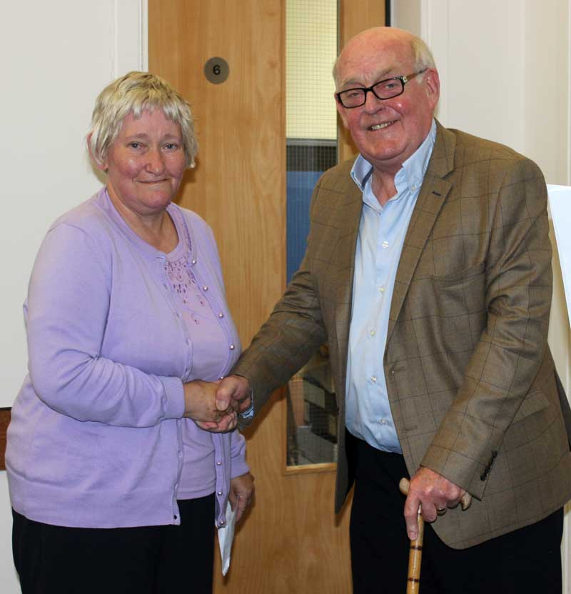 Fiona MacLeod receives the cheque from John Smith.