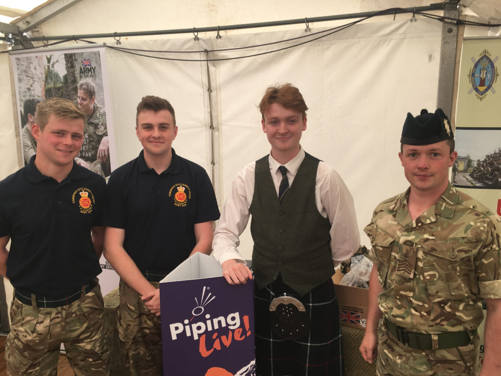 The sponsors of yesterday's Street Café, Glasgow and Strathclyde UOTC. L-R: OCDT 9officer Cadet) Thomson, Coghill, Frame and Pipe Major Bell.