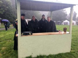 Shelter from the storm. Mark MacKenzie, William Geddes, Gordon Bruce and Gordon McCreadie seek shelter in the judges' booth this afternoon at Killin.