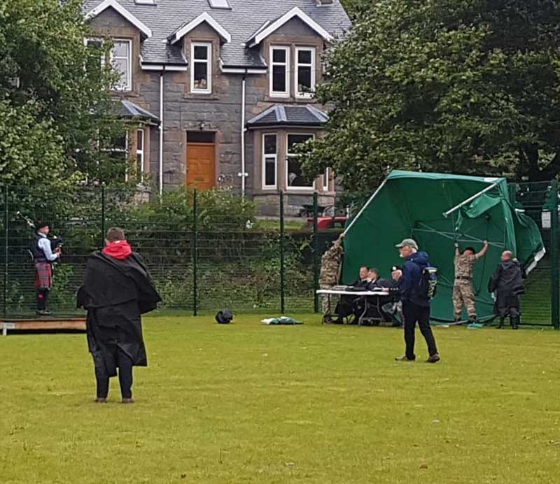 The tent housing the A Grade Strathspey & Reel judges is virtually blown away this afternoon.