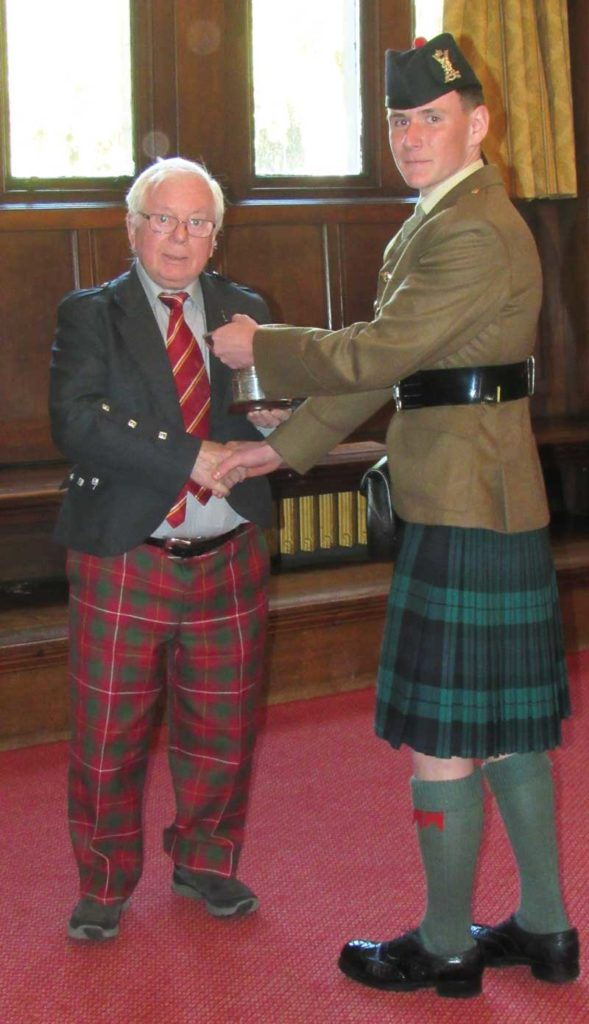 Bob presenting a trophy at the 2018 Pass Out Parade, at the Army School of Highland Bagpipe & Drumming in Edinburgh.