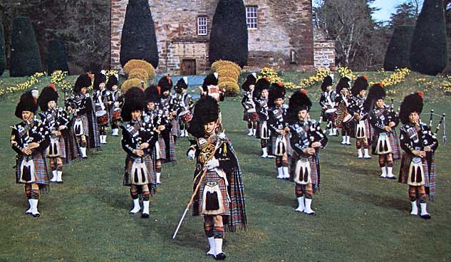 Invergordon Distillery Pipe Band pitured at Castle Leod outside Strathpeffer. Trevor Dear can be seen in the front rank, second from the right.