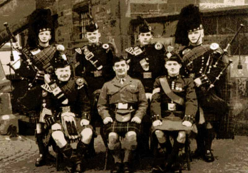 Pipe Major's Course, 1959-60, Edinburgh Castle. Back row:Lance Sergeant Angus MacDonald (Scots Guards), Corporal James Henderson (Argyll & Sutherland Highlanders), Corporal Joe Wilson (Gordon Highlanders), Lance Sergeant John Allan (Scots Guards). Front row: Pipe Major Brian Halley (Royal Scots Greys), Pipe Major John MacLellan (Director, Army School of Piping), Sergeant Eric Stewart (Irish Guards).