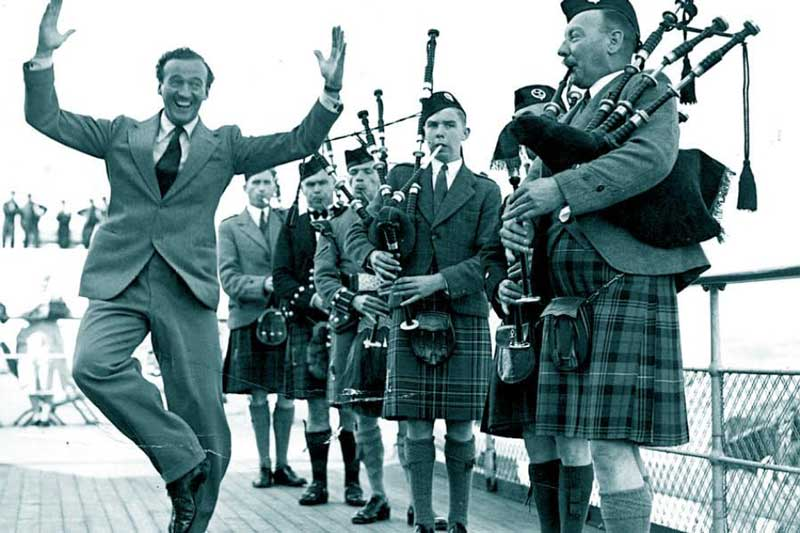 David Niven and pipers on the Queen Mary