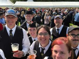Fun in the sun outside the beer tent at the 2018 World Pipe Band Championships.