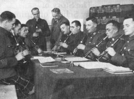 The first Army class with Canadians. L-R: Pipe Major Ed Esson, Vancouver Seaforths; L/Cpl?, Gordon Highlanders; Pipe Major Anderson, Toronto; L/Cpl?; Pipe Major Smith, The Black Watch; Pipe Major Willie Ross; L/Cpl Andrew MacNeill; L/Cpl Jimmy Gardiner, Cameronians; L/Cpl Cherry Anderson, Gordon Highlanders; Pope Major Adam MacDonald, Toronto Scottish; Pipe Major, Cameronians.
