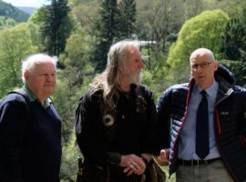 Campaigners James Rattray and John Neilson take local MSP John Swinney around the battlefield last summer.