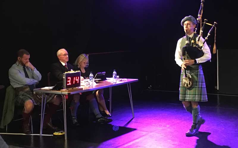 Connor Sinclair competing at last year's Argyllshire Gathering for judges Chris Armstrong, Ronnie McShannon and Patricia Henderson.
