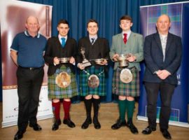 Prizewinners at last year's Duncan Johnstone Memorial Competition flanked by Duncan's two sons.