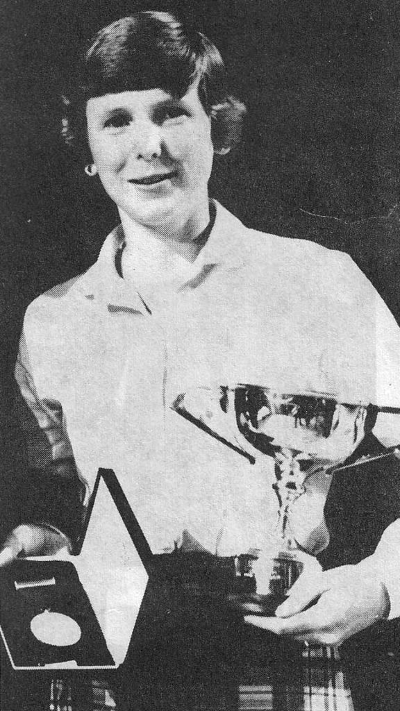 Amy Goble displaying her Silver Medal which she won at the 1981 Northern Meeting.