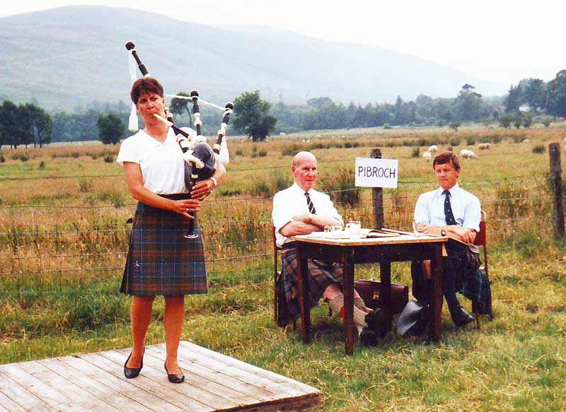 Lochearnhead, circa early 1980s. Anne Stewart plays for judges Iain Cameron and Alan Forbes.