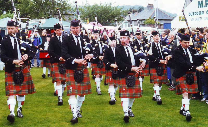 Oban Pipe Band playing at the Argyllshire Gathering (Oban Games) in 1999. Angus is in the Pipe Sergeant's position.