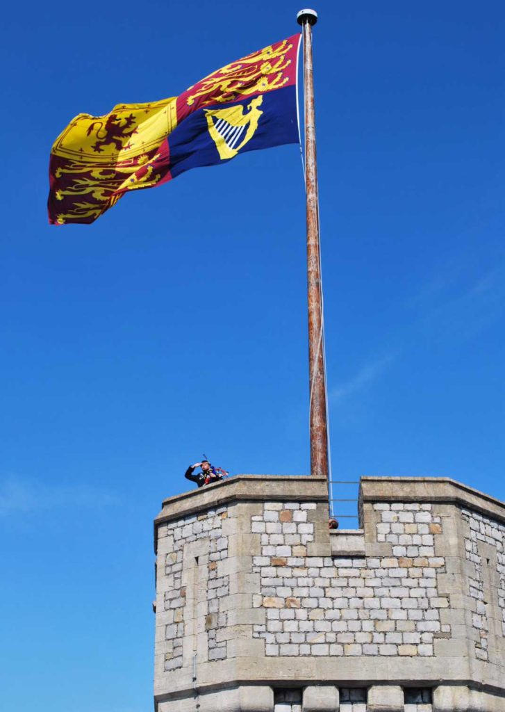 Pipe Major Grisdale, the Sovereign's Piper, at the top of Windsor Castle's iconic Round Tower on May 5.