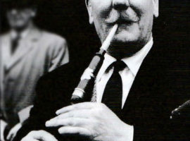 J. B. with the practice chanter he later gifted to John Shone.