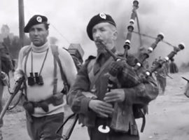 Lord Lovat, left, and Bill Millin shortly after landing in Normandy on D-Day.