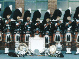 Pipe Major J. K. McAllister and Shotts and Dykehead Caledonia.