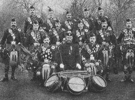 Hirsutes you, sirs! Govan Police Pipe Band, the forerunner of the famous Glasgow Police Pipe Band and the Strathclyde Police Pipe Band. It is thought that this photograph was taken during the band's visit to an orphanage in Bridge of Weir in 1886. The Pipe Major is Alasdair Hutcheon (left, front). Every band member is sporting a fantastic moustache. The gentleman in the centre, front is Chief Constable J. Hamilton.