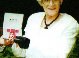 Sue with her MBE/